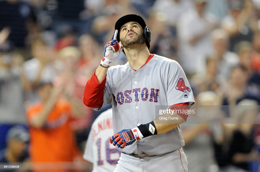 J.D. Martinez #28 of the Boston Red Sox celebrates after hitting a two-run home run in the ninth inning against the Washington Nationals at Nationals Park on July 3, 2018 in Washington, DC.