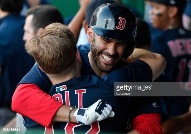 D Martinez of the Boston Red Sox celebrates his home run with Brock Holt in the second inning against the Kansas City Royals at Kauffman Stadium on...