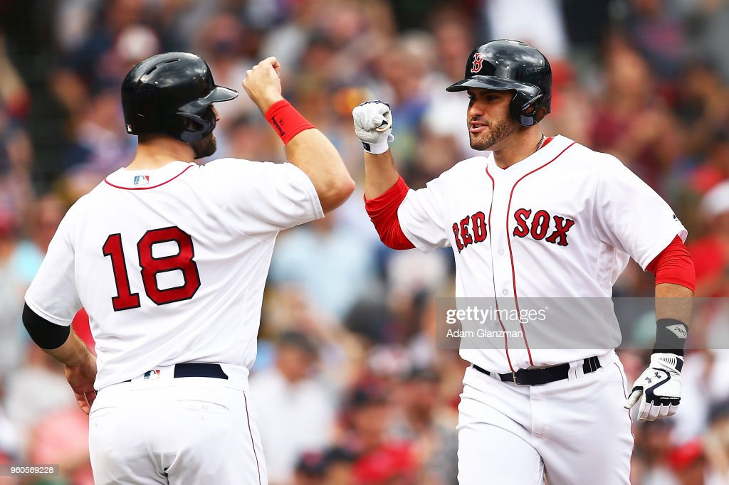 J.D. Martinez #28 of the Boston Red Sox celebrates his two-run home run with Mitch Moreland #18 in the fifth inning of a game against the Baltimore Orioles at Fenway Park on May 20, 2018 in Boston, Massachusetts.