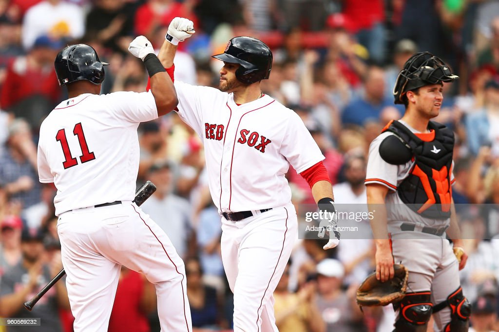 J.D. Martinez #28 of the Boston Red Sox celebrates his two-run home run with Rafael Devers #11 as Andrew Susac #27 of the Baltimore Orioles looks on in the fifth inning of a game against the Baltimore Orioles at Fenway Park on May 20, 2018 in Boston, Massachusetts.