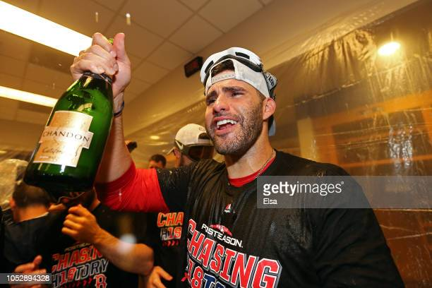 D Martinez of the Boston Red Sox celebrates in the locker room with his team after defeating the New York Yankees to win Game Four American League...