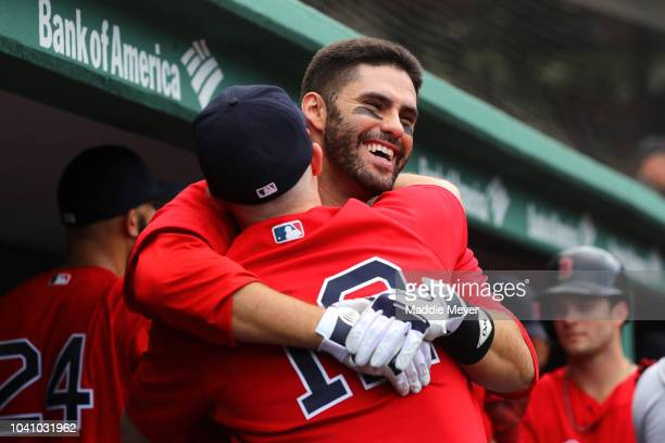 D Martinez of the Boston Red Sox celebrates with Brock Holt after hitting a three run home run against the Baltimore Orioles during the fourth inning...
