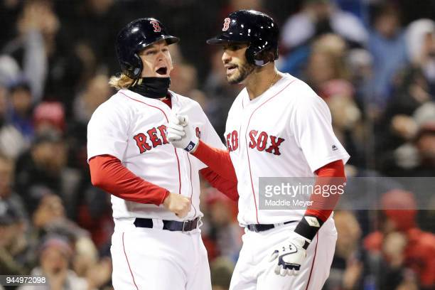 D Martinez of the Boston Red Sox celebrates with Brock Holt after he hit a grand slam during the fifth inning at Fenway Park on April 11 2018 in...