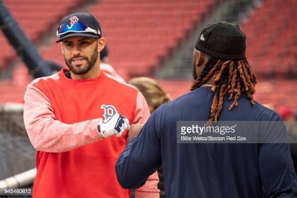 D Martinez of the Boston Red Sox high fives Hanley Ramirez before a game against the New York Yankees on April 12 2018 at Fenway Park in Boston...