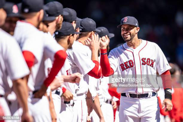 D Martinez of the Boston Red Sox high fives teammates as he is introduced before the Opening Day game against the Tampa Bay Rays on April 5 2018 at...