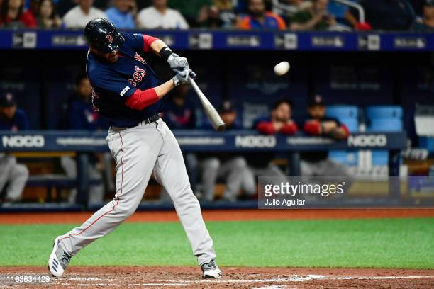 D Martinez of the Boston Red Sox hits a 3run home run off of Jalen Beeks of the Tampa Bay Rays in the third inning of a baseball game at Tropicana...