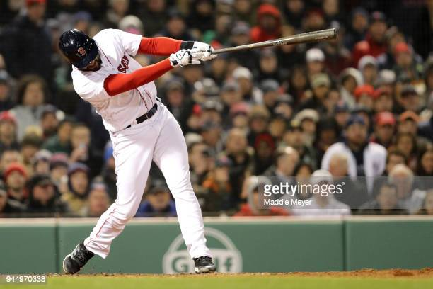 D Martinez of the Boston Red Sox hits a grand slam during the fifth inning against the New York Yankees at Fenway Park on April 11 2018 in Boston...