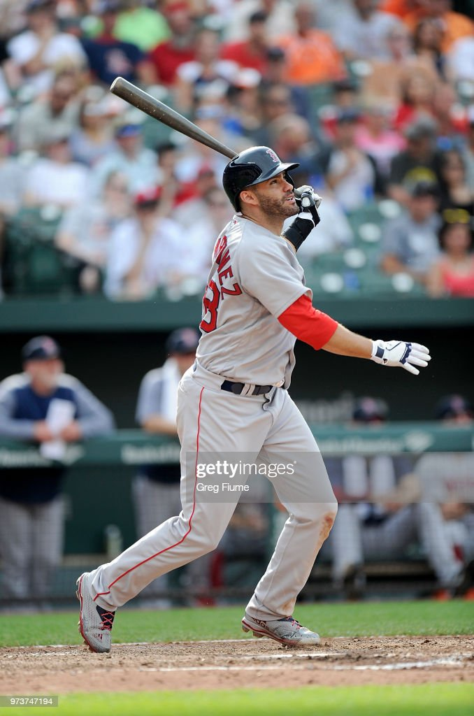 J.D. Martinez #28 of the Boston Red Sox hits a home run in the seventh inning against the Baltimore Orioles at Oriole Park at Camden Yards on June 13, 2018 in Baltimore, Maryland.