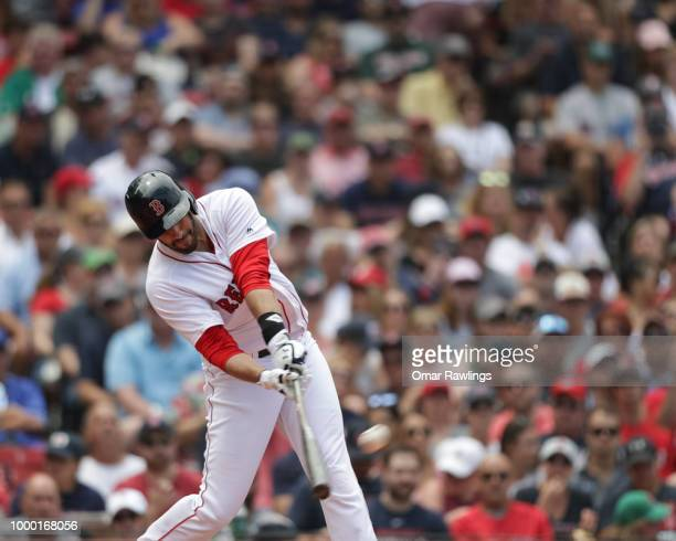D Martinez of the Boston Red Sox hits a home run single in the top of the fourth inning of the game against the Toronto Blue Jays at Fenway Park on...