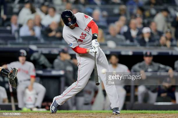 D Martinez of the Boston Red Sox hits a sac fly to left field to score Mookie Betts against Luis Severino of the New York Yankees during the third...