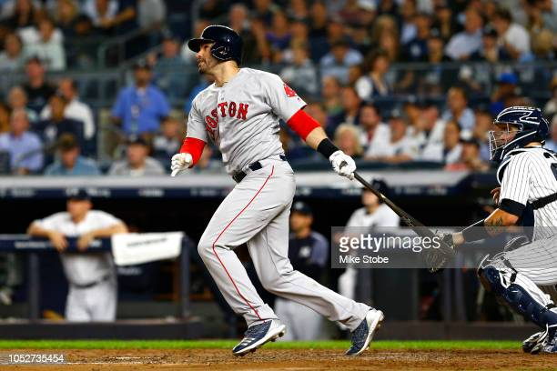 D Martinez of the Boston Red Sox hits a sacrifice fly RBI to score Andrew Benintendi against CC Sabathia of the New York Yankees during the third...