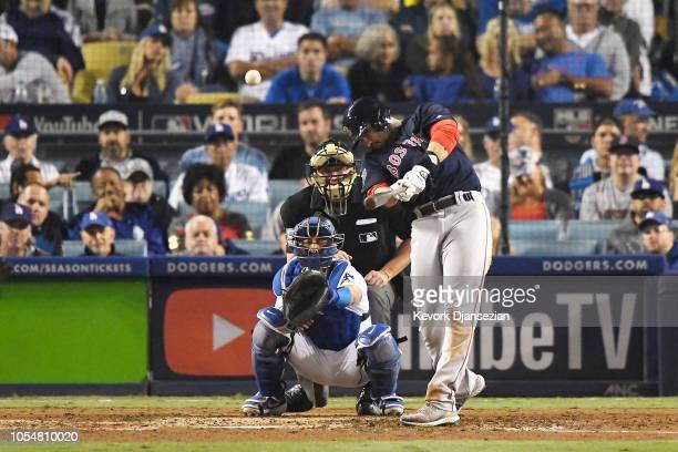 D Martinez of the Boston Red Sox hits a seventh inning home run against the Los Angeles Dodgers in Game Five of the 2018 World Series at Dodger...