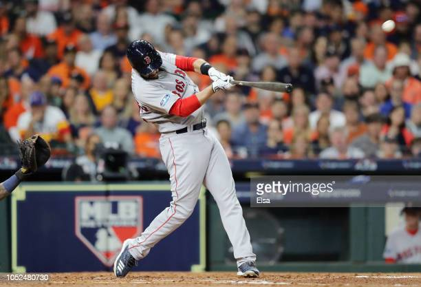D Martinez of the Boston Red Sox hits a solo home run in the third inning against the Houston Astros during Game Five of the American League...