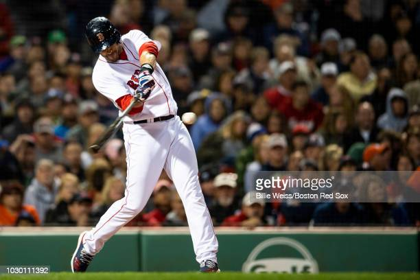 D Martinez of the Boston Red Sox hits a three run home run during the fifth inning of a game against the Houston Astros on September 7 2018 at Fenway...