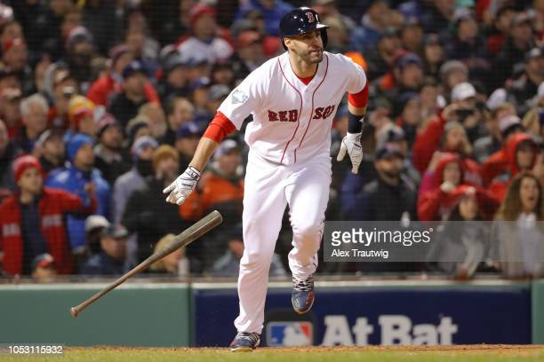 D Martinez of the Boston Red Sox hits a two run RBI single during the fifth inning of Game 2 of the 2018 World Series against the Los Angeles Dodgers...
