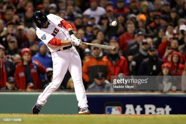 D Martinez of the Boston Red Sox hits a tworun double during the sixth inning against the Los Angeles Dodgers in Game Two of the 2018 World Series at...
