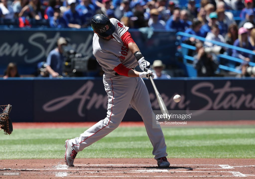 J.D. Martinez #28 of the Boston Red Sox hits a two-run home run in the first inning during MLB game action against the Toronto Blue Jays at Rogers Centre on May 13, 2018 in Toronto, Canada.
