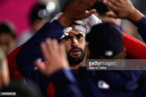 D Martinez of the Boston Red Sox is congratulated in the dugout after hitting a solo homerun during the seventh inning of a game against the Los...