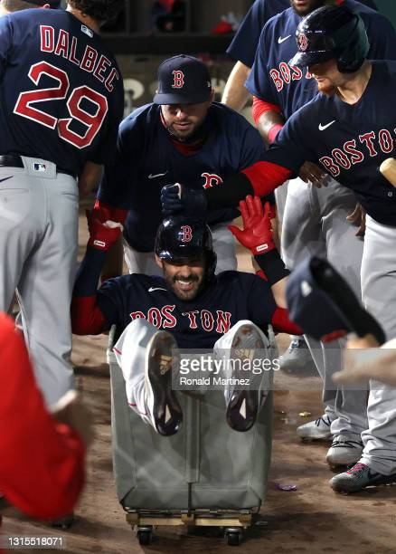 Martinez of the Boston Red Sox is pushed in a laundry cart after hitting a homerun against the Texas Rangers in the third inning at Globe Life Field...
