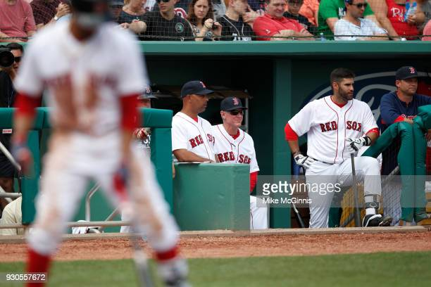 D Martinez of the Boston Red Sox on the edge of the dugout during the fourth inning of the Spring Training game against the Baltimore Orioles at Jet...