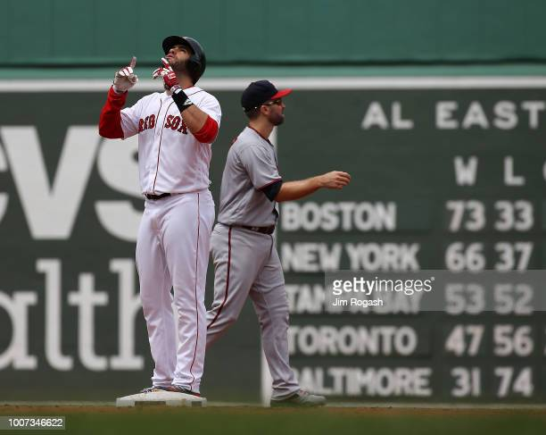 D Martinez of the Boston Red Sox reacts after he doubled in two runs against the Minnesota Twins in the second inning at Fenway Park on July 29 2018...
