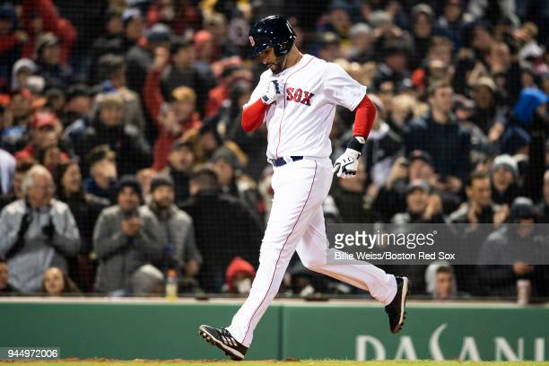 D Martinez of the Boston Red Sox reacts after hitting a grand slam home run during the fifth inning of a game against the New York Yankees on April...