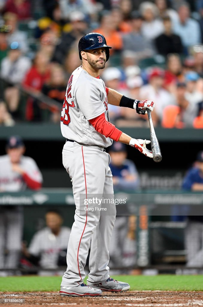 J.D. Martinez #28 of the Boston Red Sox reacts after striking out in the sixth inning against the Baltimore Orioles at Oriole Park at Camden Yards on June 11, 2018 in Baltimore, Maryland.