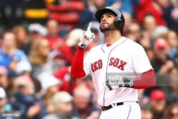 D Martinez of the Boston Red Sox reacts as he crosses home plate after hitting a solo home run in the third inning of a game against the Baltimore...