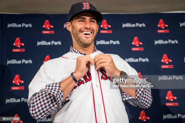 D Martinez of the Boston Red Sox reacts as he puts on a hat and jersey during a press conference announcing his signing on February 26 2018 at...