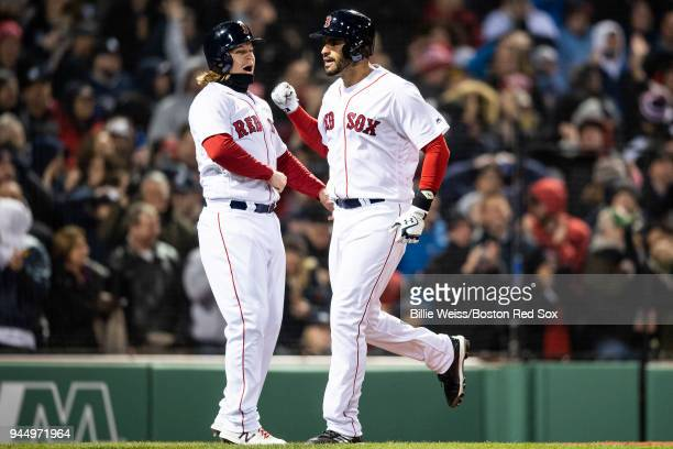 D Martinez of the Boston Red Sox reacts with Brock Holt after hitting a grand slam home run during the fifth inning of a game against the New York...