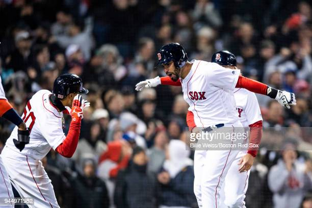 D Martinez of the Boston Red Sox reacts with Mookie Betts after hitting a grand slam home run during the fifth inning of a game against the New York...