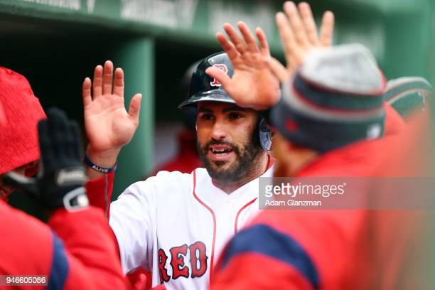 D Martinez of the Boston Red Sox returns to the dugout after scoring on a wild pitch in the sixth inning of a game against the Baltimore Orioles at...
