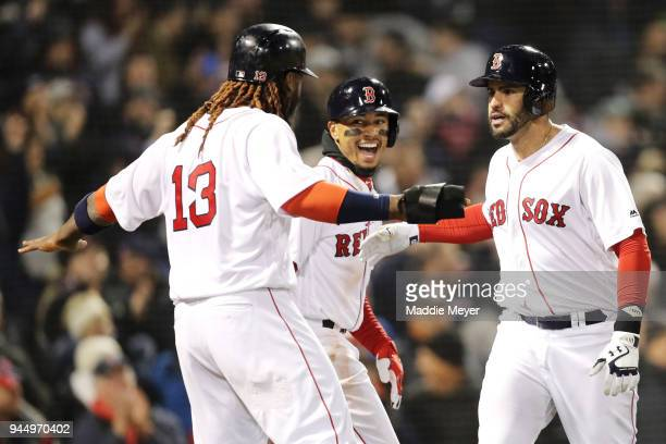 D Martinez of the Boston Red Sox right celebrates with Hanley Ramirez and Mookie Betts after hitting a grand slam during the fifth inning against the...