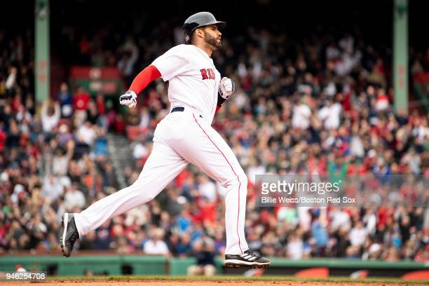 D Martinez of the Boston Red Sox rounds the bases after hitting a solo home run during the fourth inning of a game against the Baltimore Orioles on...