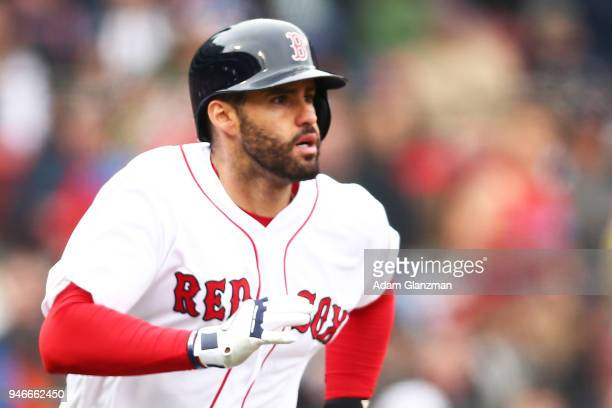 D Martinez of the Boston Red Sox rounds the bases after hitting a solo home run in the third inning of a game against the Baltimore Orioles at Fenway...