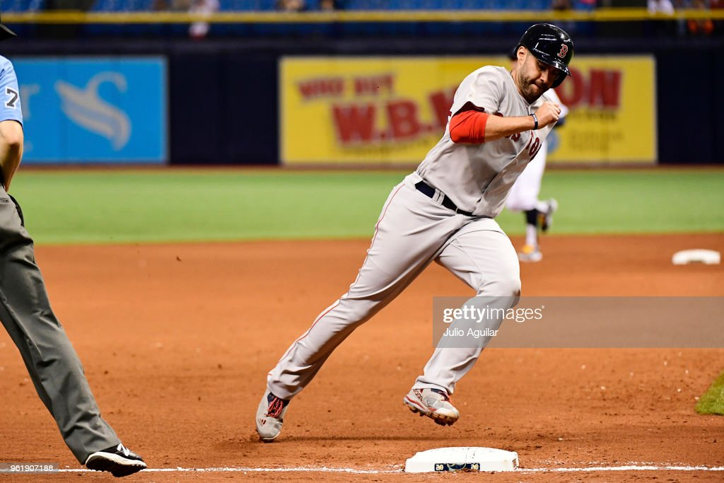 J.D. Martinez #28 of the Boston Red Sox rounds third base in the ninth inning against the Tampa Bay Rays on May 23, 2018 at Tropicana Field in St Petersburg, Florida. The Red Sox won 4-1.