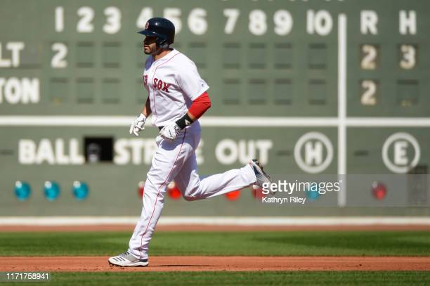 Martinez of the Boston Red Sox runs the bases after hitting a solo home run in the first inning against the Baltimore Orioles at Fenway Park on...