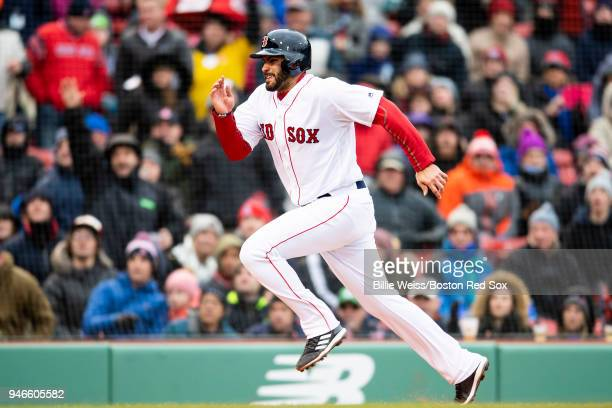 D Martinez of the Boston Red Sox runs toward home plate to score on a wild pitch during the sixth inning of a game against the Baltimore Orioles on...