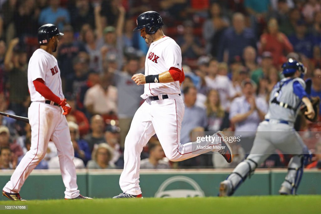 J.D. Martinez #28 of the Boston Red Sox scores a run against the Toronto Blue Jays during the eighth inning at Fenway Park on September 11, 2018 in Boston, Massachusetts.