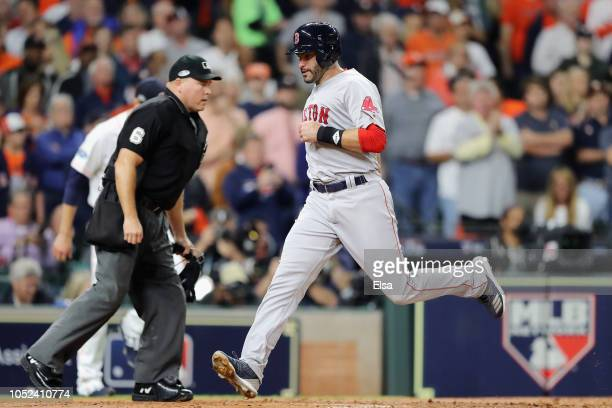 Martinez of the Boston Red Sox scores a run in the first inning against the Houston Astros during Game Four of the American League Championship...