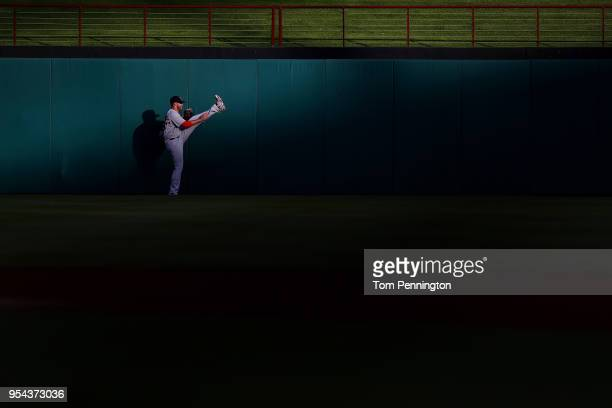 D Martinez of the Boston Red Sox stretches in the outfield before taking on the the Texas Rangers at Globe Life Park in Arlington on May 3 2018 in...