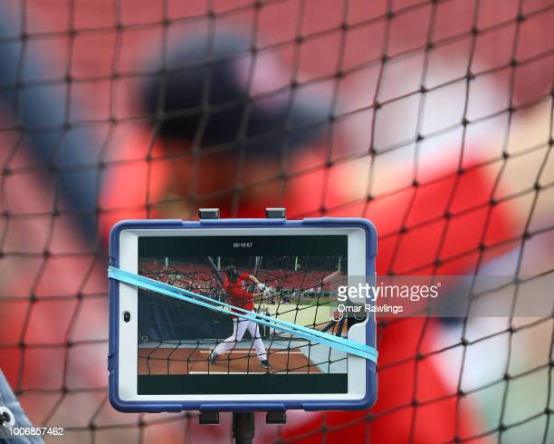 D Martinez of the Boston Red Sox takes batting practice while being filmed on an iPad before the game against the Minnesota Twins at Fenway Park on...