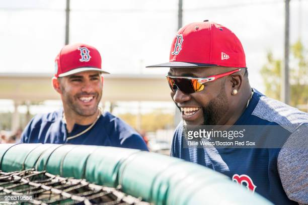 D Martinez of the Boston Red Sox talks with former designated hitter David Ortiz during a team workout on March 2 2018 at Fenway South in Fort Myers...