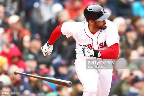 D Martinez of the Boston Red Sox tosses his bat as he runs to first base in the sixth inning of a game against the Baltimore Orioles at Fenway Park...