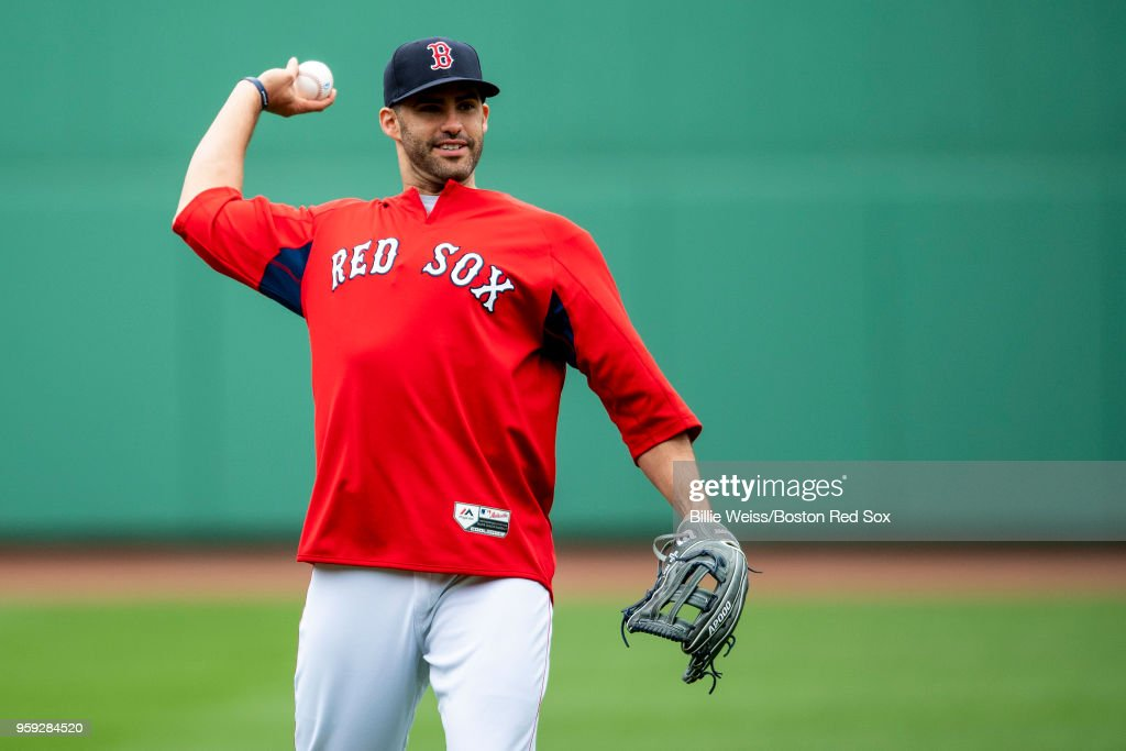 J.D. Martinez #28 of the Boston Red Sox warms up before a game against the Oakland Athletics on May 16, 2018 at Fenway Park in Boston, Massachusetts.