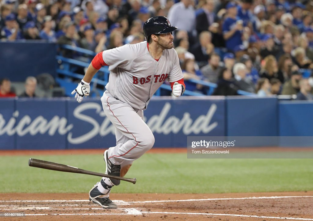J.D. Martinez #28 of the Boston Red Sox watches as he hits a three-run home run in the fifth inning during MLB game action against the Toronto Blue Jays at Rogers Centre on April 26, 2018 in Toronto, Canada.