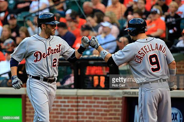 D Martinez of the Detroit Tigers celebrates after hitting a solo home run to right field in the second inning against Chris Tillman of the Baltimore...