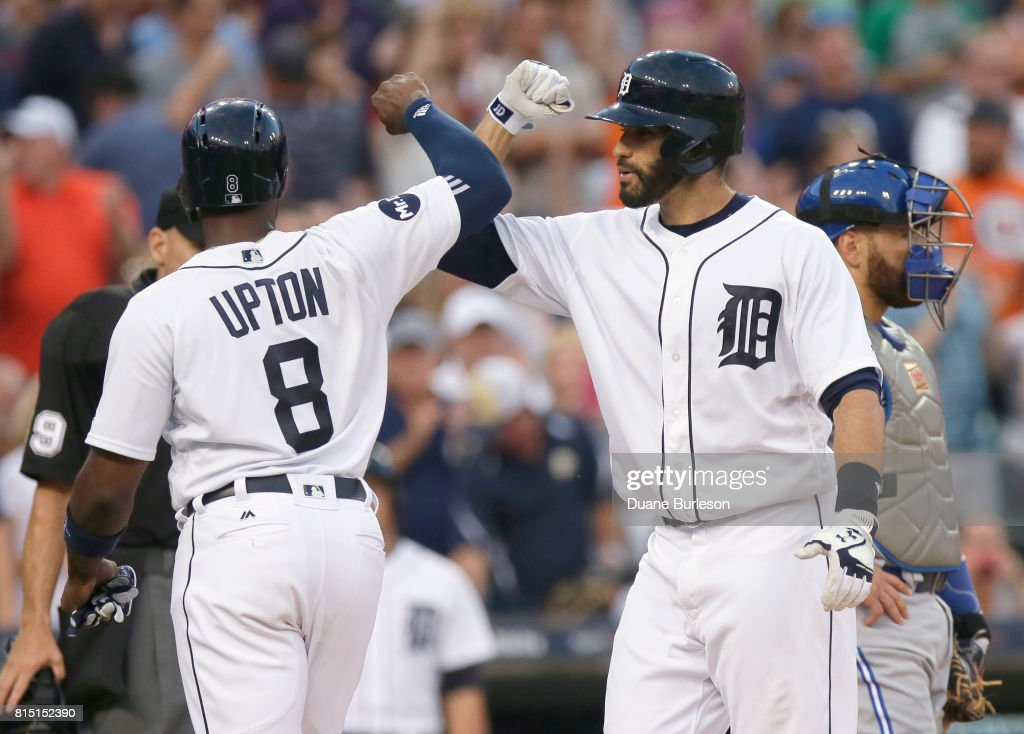 J.D. Martinez #28 of the Detroit Tigers celebrates with Justin Upton #8 of the Detroit Tigers after hitting a three-run home run against the Toronto Blue Jays during the eighth inning at Comerica Park on July 15, 2017 in Detroit, Michigan.
