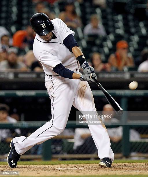 D Martinez of the Detroit Tigers hits a grand slam against the Kansas City Royals during the ninth inning at Comerica Park on June 16 2014 in Detroit...