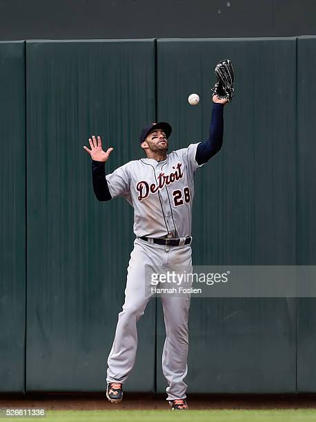 D Martinez of the Detroit Tigers misses a catch in right field of the ball hit by John Ryan Murphy of the Minnesota Twins during the fifth inning of...